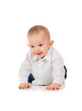 Beautiful the child in clothes crawling on the floor Royalty Free Stock Photography