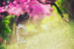 Beautiful child with dandelion flower in spring park. Happy kid. Having fun outdoors Royalty Free Stock Images