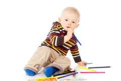 Beautiful child draws Stock Photography