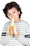 Beautiful child eating a banana Royalty Free Stock Photography
