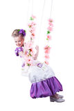 Beautiful child on floral swing isolated Royalty Free Stock Photography