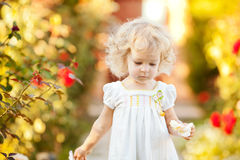 Beautiful child in garden Stock Photo