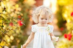 Beautiful child in garden Stock Photo