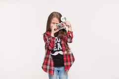 Beautiful child girl holding a instant camera Stock Image