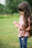 Beautiful child girl with long hair outdoors Royalty Free Stock Image