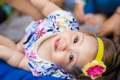 Beautiful child girl looking to the camera and smiling stock photography