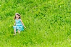 Beautiful child girl in park. Happy kid having fun outdoo. Beautiful child with dandelion flower in spring park. Happy kid having fun outdoors Royalty Free Stock Photo