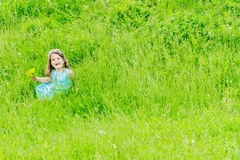 Beautiful child girl in park. Happy kid having fun outdoo. Beautiful child girl with dandelion flower in spring park. Happy kid having fun outdoors Royalty Free Stock Photo