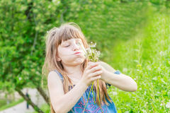 Beautiful child girl in park. Happy kid having fun outdoo. Beautiful child girl with dandelion flower in spring park. Happy kid having fun outdoors Stock Photos