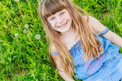 Beautiful child girl in park. Happy kid having fun outdoo Stock Photos
