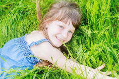 Beautiful child girl in park. Happy kid having fun outdoo Stock Images