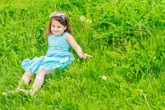 Beautiful child girl in park. Happy kid having fun outdoo Stock Photography