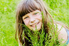 Beautiful child girl in park. Happy kid having fun outdoo Royalty Free Stock Photo