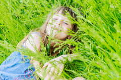 Beautiful child girl in park. Happy kid having fun outdoo Stock Photo