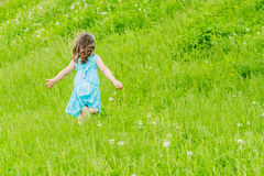 Beautiful child girl in park. Happy kid having fun outdoo Royalty Free Stock Photography
