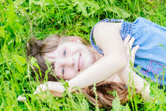 Beautiful child girl in park. Happy kid having fun outdoo Stock Image