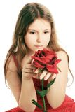 Beautiful child girl with red rose. Stock Images