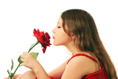 Beautiful child girl with red rose. Royalty Free Stock Photo