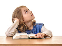Beautiful child girl at school looking up Royalty Free Stock Image