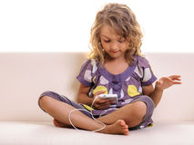 Beautiful child girl with smart cell phone Royalty Free Stock Image