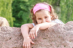 Beautiful child girl in spring park. Happy kid having fun. Outdoors Stock Images
