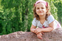 Beautiful child girl in spring park. Happy kid having fun. Outdoors Royalty Free Stock Photos