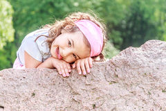 Beautiful child girl in spring park. Happy kid having fun outdoors Royalty Free Stock Image