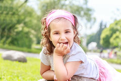 Beautiful child girl in spring park. Happy kid having fun outdoors Royalty Free Stock Photos