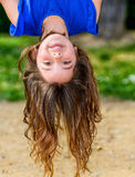 Beautiful child hanging upside Stock Image