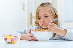 Beautiful child having breakfast at home. Stock Photos