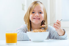 Beautiful child having breakfast at home. Stock Photography