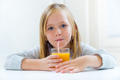 Beautiful child having breakfast at home. Stock Photos