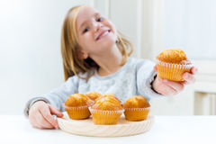 Beautiful child having breakfast at home. Royalty Free Stock Photography