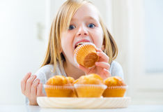 Beautiful child having breakfast at home. Royalty Free Stock Images