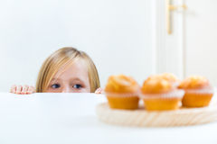 Beautiful child having breakfast at home. Royalty Free Stock Photos