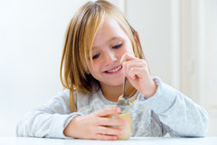 Beautiful child having breakfast at home. Royalty Free Stock Image