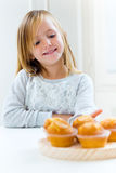 Beautiful child having breakfast at home. Royalty Free Stock Photos