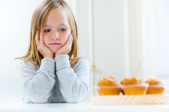 Beautiful child having breakfast at home. Stock Images