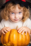 Beautiful child holding a pumpkin stock photography