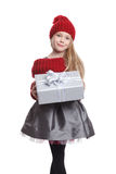 Beautiful child holding a wrapped present Stock Image
