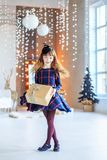 A beautiful child holds a gift box and dances. Long hair. Concep Royalty Free Stock Photography