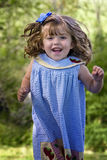 Beautiful child jumping for joy Royalty Free Stock Photo