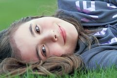 Beautiful child laying in grass Royalty Free Stock Photography