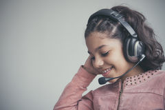 Beautiful child listening to the music Stock Images