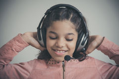 Beautiful child listening to the music Stock Image