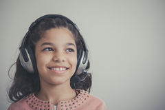 Beautiful child listening to the music Stock Photos