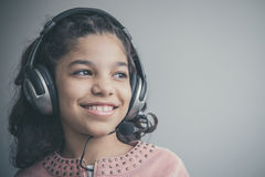 Beautiful child listening to the music Royalty Free Stock Image