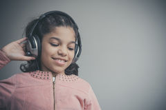 Beautiful child listening to the music Royalty Free Stock Images