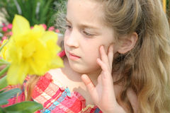 Beautiful child looking at flowers Royalty Free Stock Photos