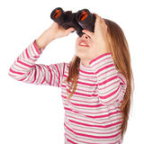 Beautiful child looks through the binoculars. Isolated on white background Stock Photos
